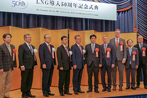 Governor Dunleavy standing on stage during a celebration of LNG in Japan