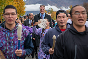 Governor Dunleavy marching with Alaskans during a Domestic Violence Awareness March